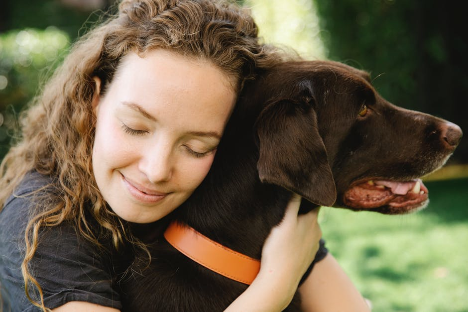A close up of a woman with a dog